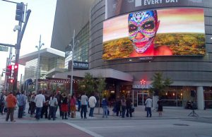 Digital art captivates an audience at the Colorado Convention Center.