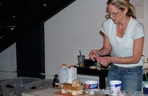 Sarah Fox gets her hands dirty teaching kids art.