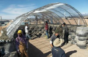 Earthships are curvy, curious structures -- half kiva, half greenhouse, both high and low tech.