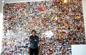 "Novick in front of ""Sweet Tooth: Photos of 1000 Desserts (that I ate)"" at The Shoppe."