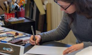 Maria Mangano signs her prints