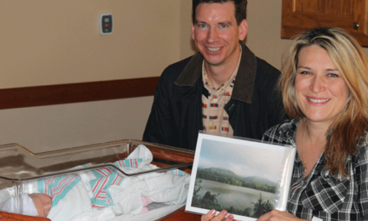 Matthew Conboy with a newborn collector at St. Clair Hospital