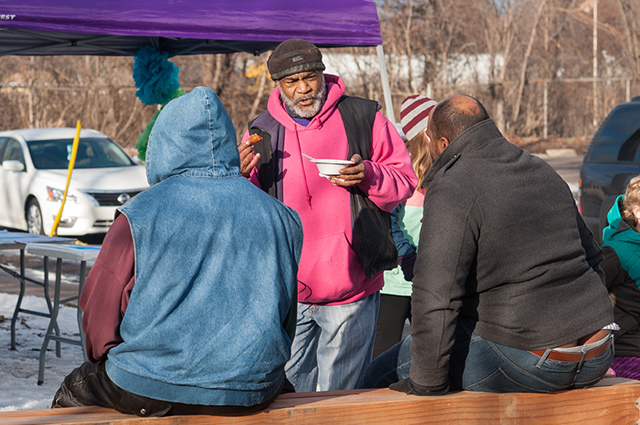 Friendly Street organizer Melvin Giles greets Rondo neighbors at a winter festival near I-94. Photo Credit: David Gonzalez/MNDOT