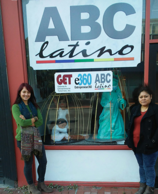 Isabel Velsaco Gomez (right) displays her sculptures in a Poughkeepsie business.