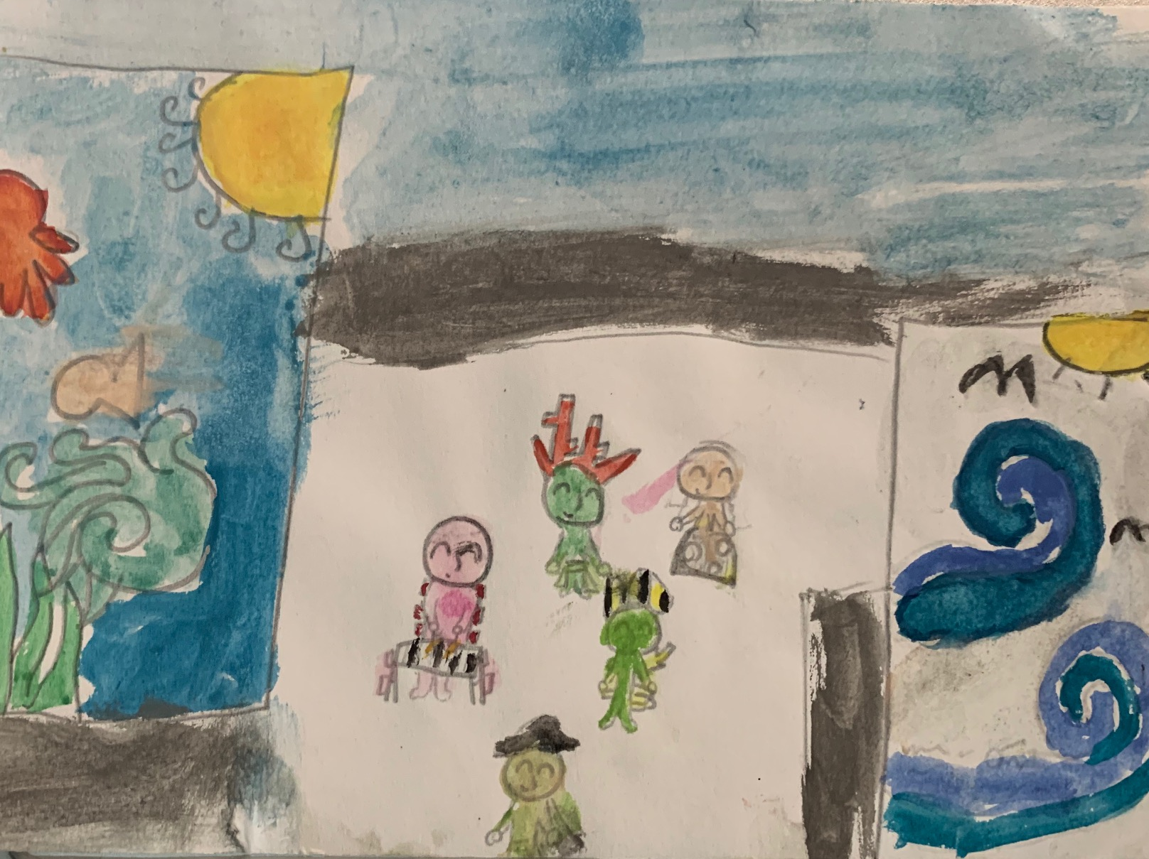 A child's drawing featuring people and ocean elements.