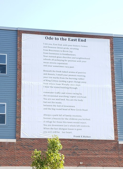 A building with a large poem, Ode to East End, on its wall