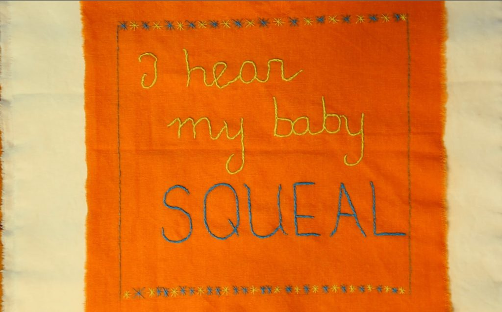 """Embroidery reading """"I hear my baby squeal"""""""