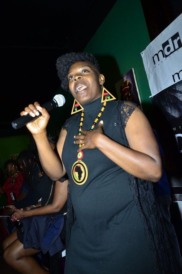 Ayolanda speaking at a fashion show she designed.